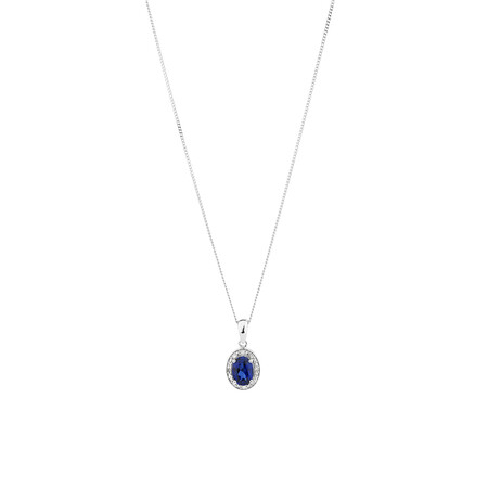 Halo Pendant with Created Blue Sapphire and 0.04 TW of Diamonds in Sterling Silver