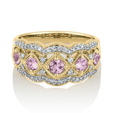 Ring with Created Pink Sapphire & 0.25 Carat TW of Diamonds in 10ct Yellow Gold