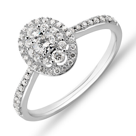 Halo Engagement Ring with 0.45 Carat TW of Diamonds in 10ct White Gold