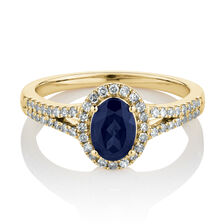 Ring with Created Blue Sapphire & 0.25 Carat TW of Diamonds in 10ct Yellow Gold