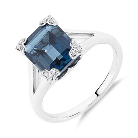 Ring With Diamonds And Blue Topaz In Sterling Silver