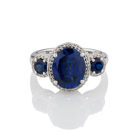 Three Stone Ring with Created Blue Sapphire & 0.20 Carat TW of Diamonds in 10ct White Gold