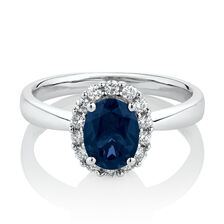 Ring with Created Sapphire & 0.25 Carat TW of Diamonds in 10ct White Gold