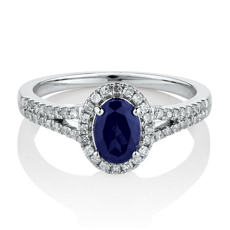 Ring with Created Blue Sapphire & 0.25 Carat TW of Diamonds in 10ct White Gold