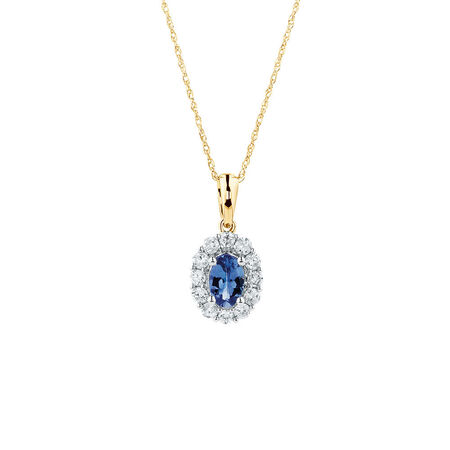 Pendant with Tanzanite & 1/3 Carat TW of Diamonds in 10ct Yellow & White Gold