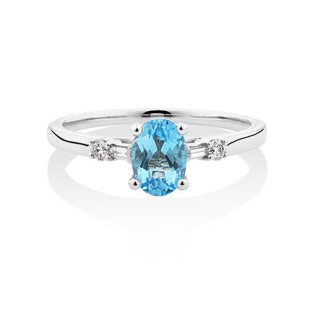 Ring with Blue Topaz & 0.10 Carat TW of Diamonds in 10ct White Gold