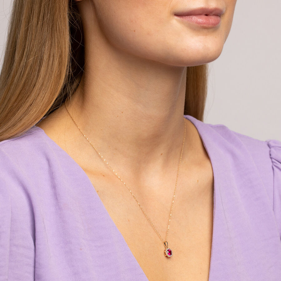 Halo Pendant with 0.09 Carat TW of Diamonds in 10ct Yellow Gold