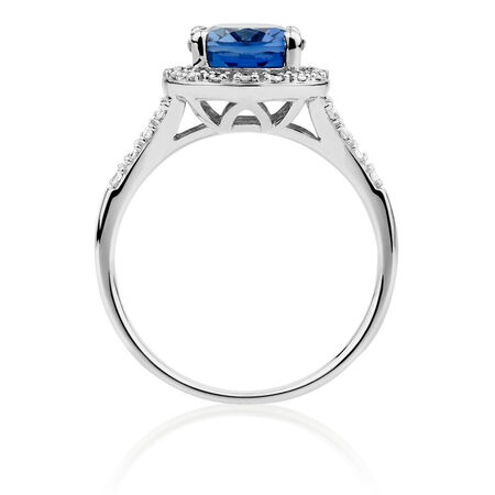 Ring with Created Sapphire & 0.20 Carat TW of Diamonds in 10ct White Gold