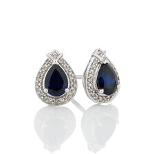 Earrings with Created Blue Sapphire & 0.18 Carat TW of Diamonds in 10ct White Gold